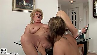 Filthy mature whore gets her most dripping cunt swallowed by lesbo